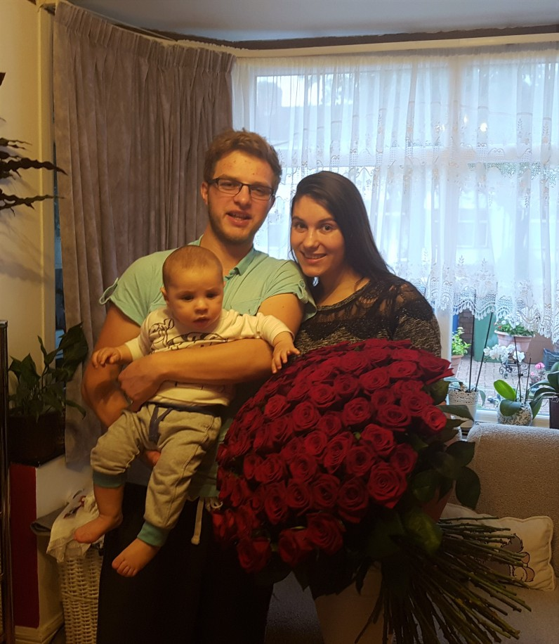 Baby Nathan likes the flowers that mummy received :)